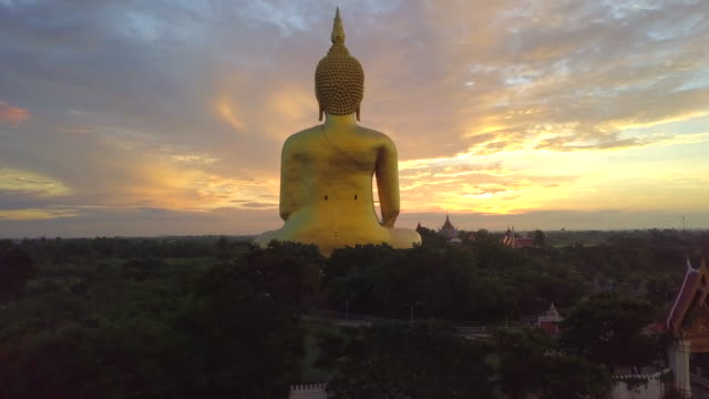 aerial view of sunrise at big buddha wat muang landmark of ang thong province, thailand - buddha video stock e b–roll
