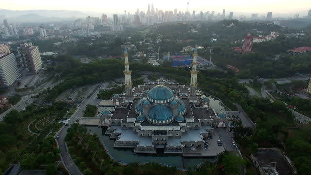 Aerial view of sunrise at Federal Mosque Kuala Lumpur with city skyline at the background video
