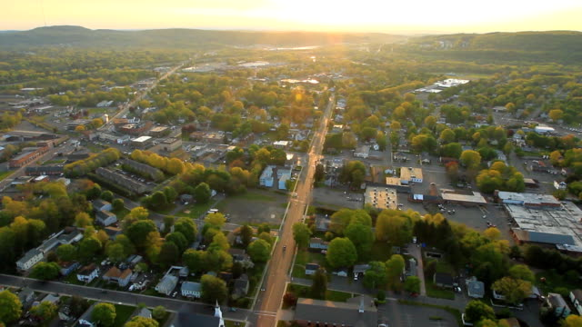 Aerial view of sunrise over suburban landscape video