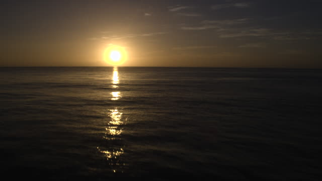 Aerial view of sunrise over the ocean video