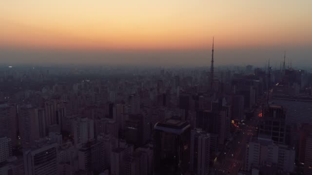 Aerial view of sunset at downtown with a beautiful sky. Fantastic landscape. Famous Costa and Silva Bridge, Sao Paulo, Brazil.