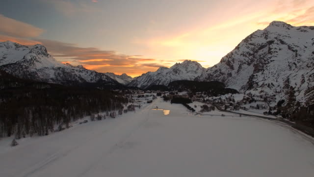 Aerial view of sunset in Alps mountains, near Saint Moritz in Winter, Switzerland video