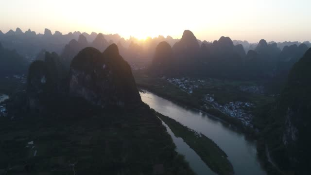 aerial view of sunset over karst mountain landscape of Yangshuo, Guanxi province, China.