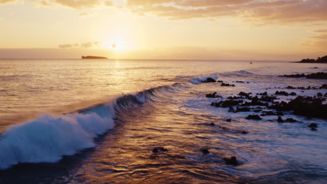 Aerial View of Sunset Waves and Ocean video