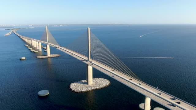 Aerial view of Sunshine Skyway, Tampa Bay Florida Aerial view of Sunshine Skyway, Tampa Bay Florida, USA. Big steel cable suspension bridge. suspension bridge stock videos & royalty-free footage
