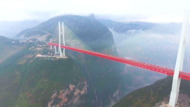 Aerial view of Suspension Bridge Connect Between the Mountain, Ghuizhou, China Aerial view of Suspension Bridge Connect Between the Mountain, Ghuizhou, China suspension bridge stock videos & royalty-free footage