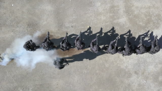 Aerial view of Swat Police Officers Shooting With Firearm