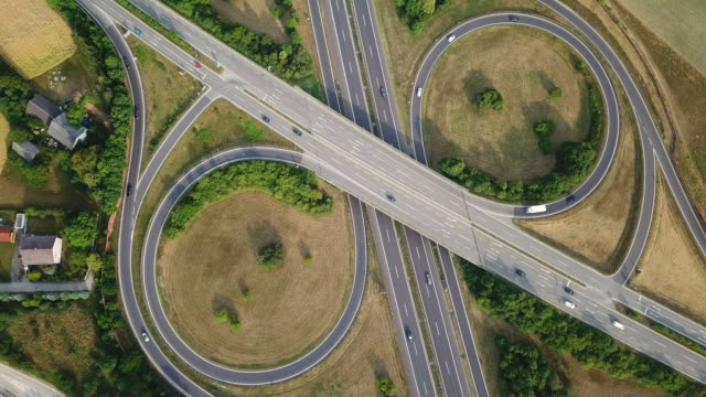 aerial view of symetric highway interchange, austria - autobahn video stock e b–roll