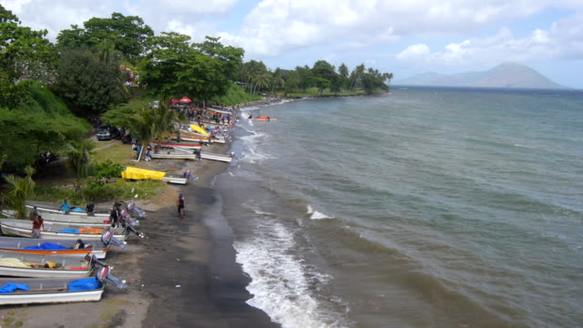 Aerial view of taxi boats on the beach in Papua New Guinea video