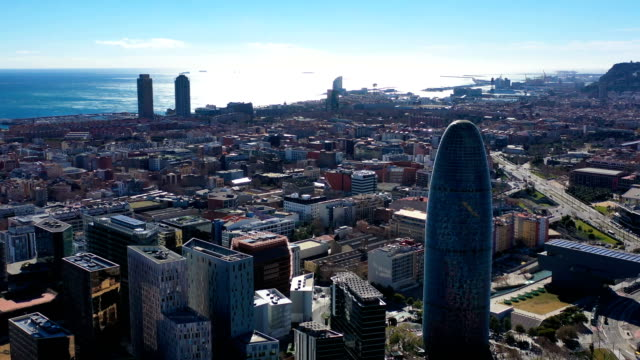 Aerial view of technological district of Barcelona, Catalonia, Spain. Torre Glories Torre Agbar . Summer time. Backlight. Drone video footage - video