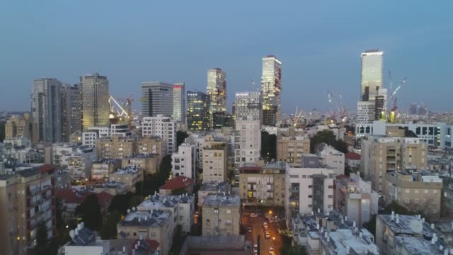 Aerial view of Tel aviv skyline. Urban landscape at sunset evening with skyscraper view and Sea water in horizon