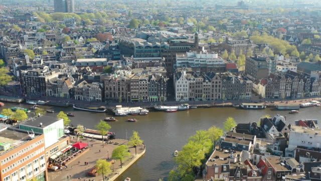 aerial view of the amstel river and traditional old buildings - amsterdam video stock e b–roll
