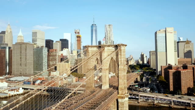 Aerial view of the Brooklyn bridge through the East river to Manhattan district in New York, America video