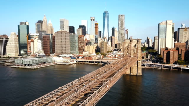 Aerial view of the Brooklyn bridge to Manhattan in New York, America through the East river in sunny day video