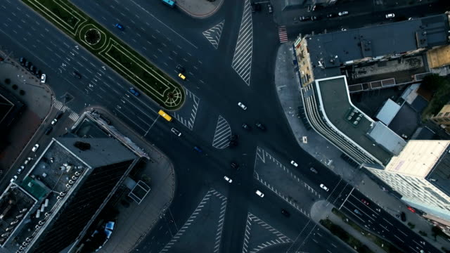 Aerial View of The Bustling Traffic on The Road at the Crossroads in Cloudy Weather in the Big City, Shot in 4K UHD video