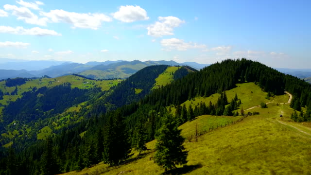 Aerial view of the Carpathian Mountains and a road on top, Ukraine. Drone flight video