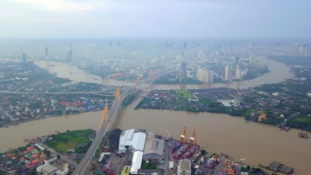 aerial view of the chao phraya river bridge of bangkok thailand - fiume chao phraya video stock e b–roll