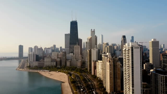 Aerial view of the Chicago, America. Drone flying up to the downtown, skyscrapers on the shore of the Michigan lake