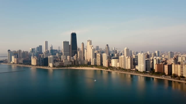 Aerial view of the Chicago, USA on the shore of the lake Michigan in the down. Boat riding near the downtown Aerial view of the Chicago, USA on the shore of the lake Michigan in the down. Boat riding near the downtown. Copter flying near the skyscrapers and beach in the morning. chicago architecture stock videos & royalty-free footage