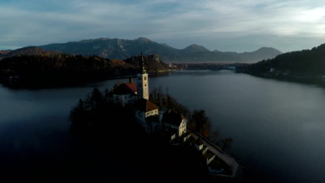 aerial view of the church in bled island - ferragosto video stock e b–roll
