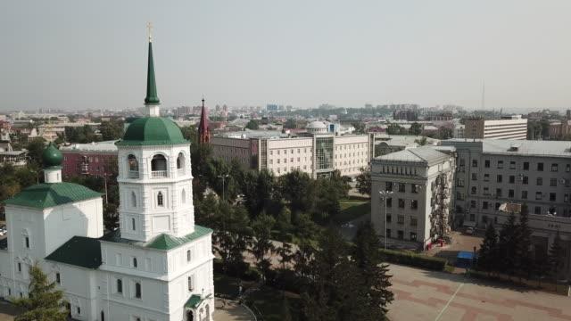 vídeos de stock e filmes b-roll de aerial view of the church in the name of the savior of the holy image in irkutsk - irkutsk