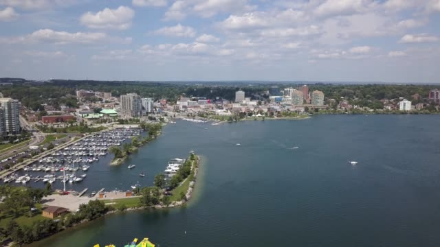 Aerial view of the city and lake 4k Flying with drone above downtown of Barrie and Lake Simcoe coastal feature stock videos & royalty-free footage