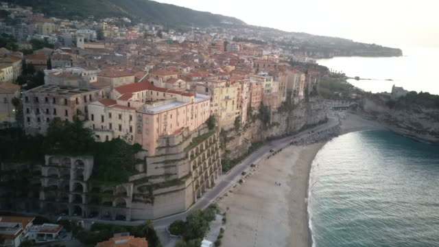 aerial view of the city beach along the mediterranean coast of southern italy. - video di tropea video stock e b–roll