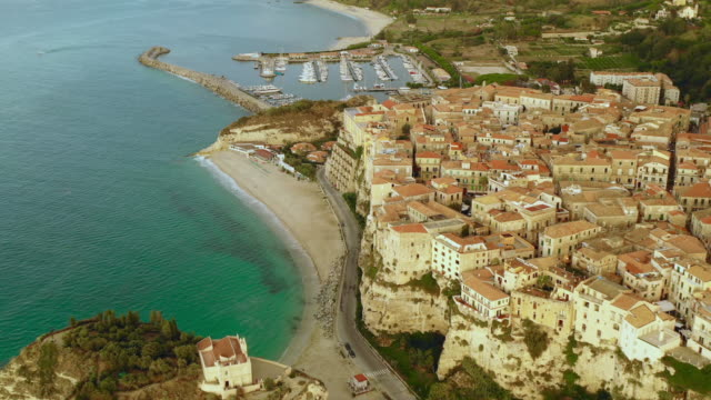 aerial view of the city, coastline, harbor and sea - tropea video stock e b–roll