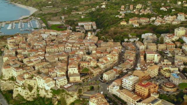 aerial view of the city, coastline, harbor and sea - video di tropea video stock e b–roll