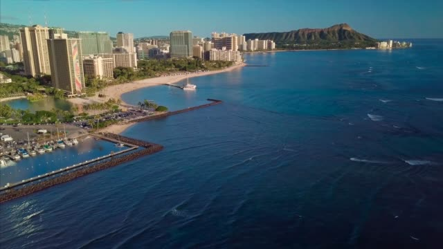 Aerial view of the city of Honolulu Aerial view of the city of Honolulu with Diamond Head volcano on the horizon. The island of Oahu, Hawaii waikiki stock videos & royalty-free footage