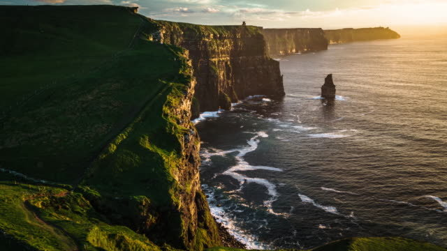 aerial view of the cliffs of moher at sunset. ireland. - cliffs stock videos & royalty-free footage