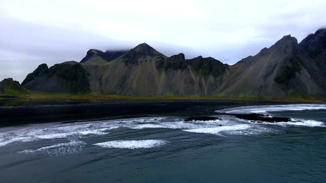 Aerial view of the coastline with mountains in Iceland video