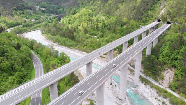 aerial view of the concrete highway viaduct on concrete pillars in the mountains - autobahn video stock e b–roll
