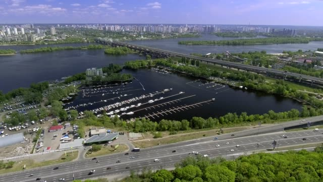 Aerial view of the Darnitskiy Bridge through the Dnipro river in Kiev, Ukraine video