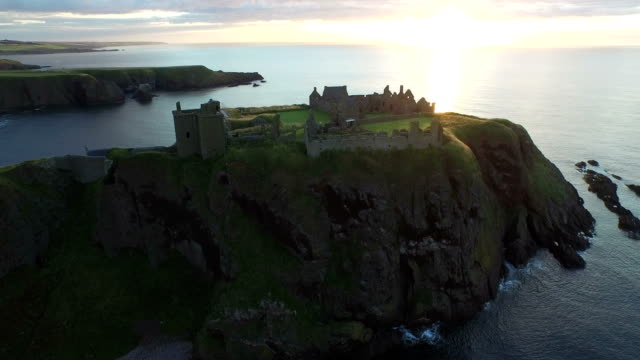 Aerial view of the Dunnottar Castle at sunrise
