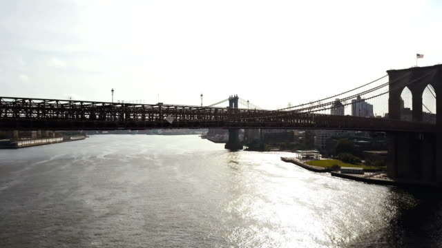 Aerial view of the East river in New York, America. Drone flying over the Brooklyn bridge, view on Manhattan bridge video