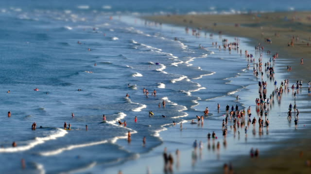 aerial view of the english beach, canary islands.time lapse. tilt-shift effect. - movimento rapido video stock e b–roll