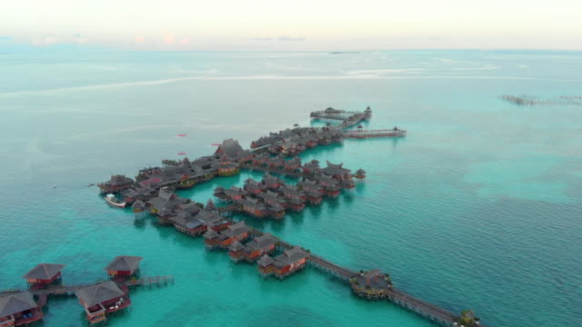 aerial view of the floating resorts of mabul. one of the most beautiful dive spots in the world. shot in 4k. - malaysia video stock e b–roll