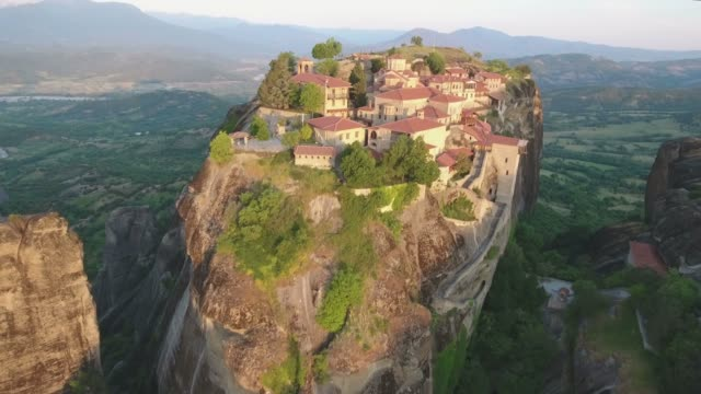 aerial view of the great meteoron - meteora in greece - rock formations stock videos & royalty-free footage