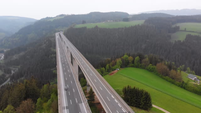 Aerial view of the Highway Viaduct on Concrete Pillars in the Mountains