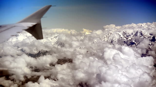 Aerial view of the Himalayas mountain range from the airplane window video