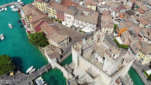 Aerial view of the historic city by the lake with a medieval castle