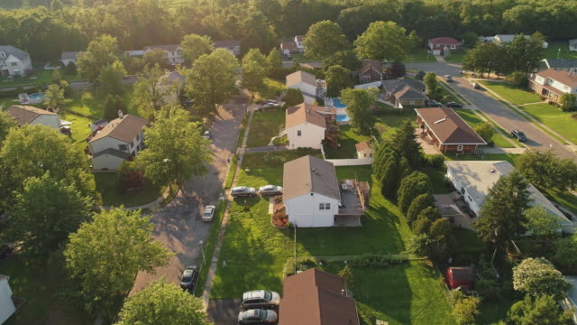 Aerial view of the houses in the suburban areas in Sayerville, New Jersey, USA. Drone-made video footage with the panoramic camera motion.
