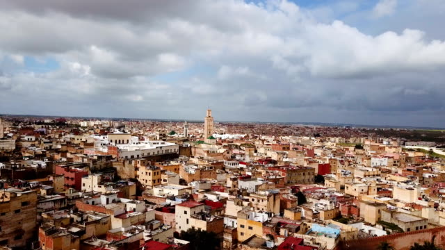 Aerial view of the imperial city of Meknes. We can see the rooftops of the city under cloudy sky.