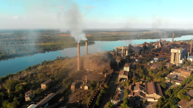 aerial view of the industrial plant with smoking pipes near the city. industrial zone - ukraina filmów i materiałów b-roll