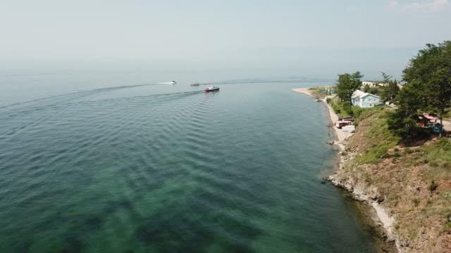 vídeos de stock e filmes b-roll de aerial view of the lake baikal - lago baikal
