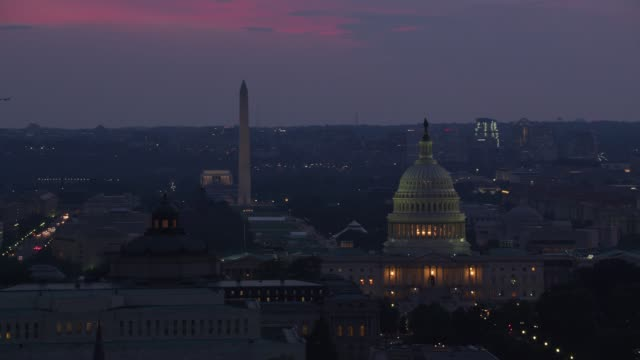 Aerial view of the Lincoln Memorial, Washington Monument and Capitol Building at dusk.
