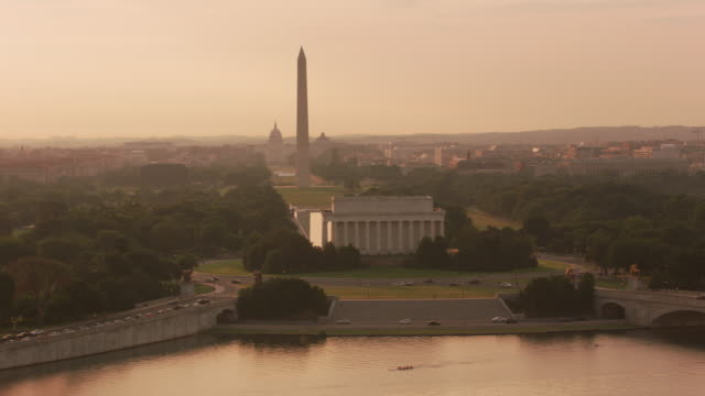 Aerial view of the Lincoln Memorial, Washington Monument and Capitol Building at sunrise.
