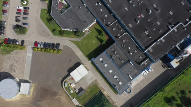 Aerial view of the logistics warehouse with trucks waiting for loading Aerial view of the logistics warehouse with trucks waiting for loading warehouse aerial stock videos & royalty-free footage