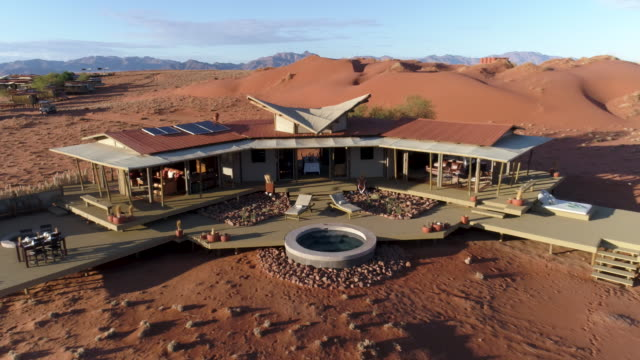 Aerial view of the luxury accommodation at Wolwedans, Namibia Aerial view of the luxury accommodation at Wolwedans, Namibia namibia stock videos & royalty-free footage